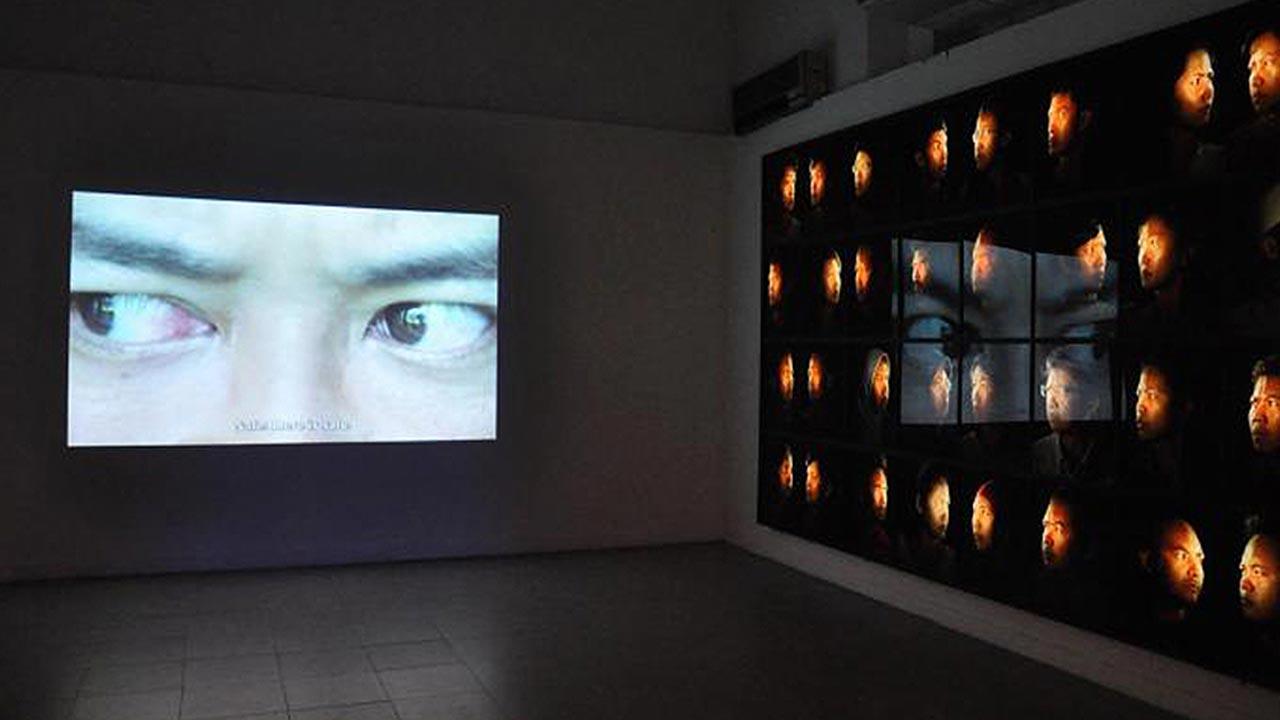(Re Hartanto, '99 Faces', photo installation and single channel video projection, Jakarta Biennale 2011